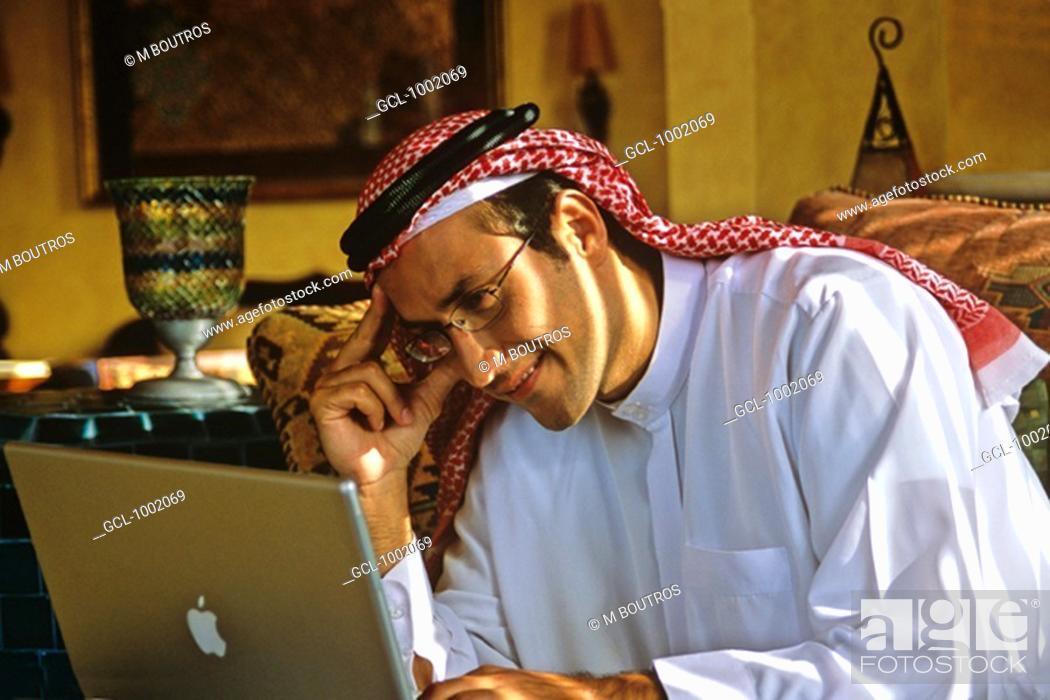 Stock Photo: Arab man using a laptop.