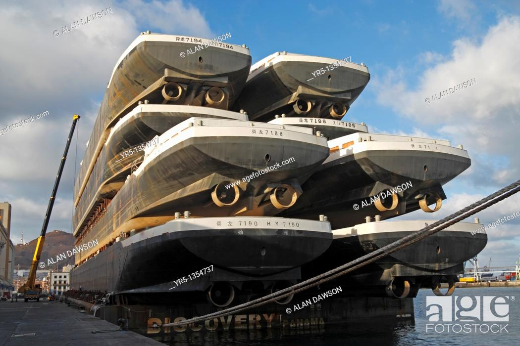 Stock Photo: Eight new boats stacked on platform being towed from shipyard in China to Europe  Puerto de La Luz, Las Palmas, Gran Canaria, Canary Islands, Spain.