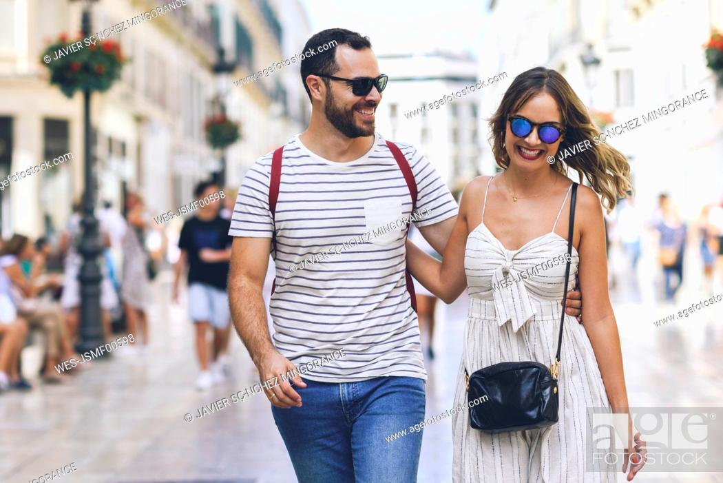 Stock Photo: Spain, Andalusia, Malaga, happy tourist couple walking in the city.