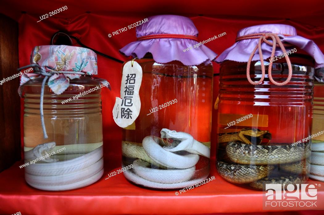 Stock Photo: Naha (Okinawa, Japan): Habu (viper) awamori sold to tourists along Kokusai-dori.