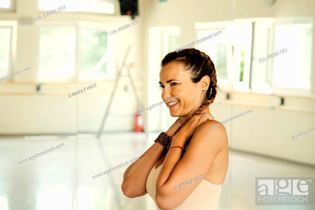 Stock Photo: Woman in yoga studio.