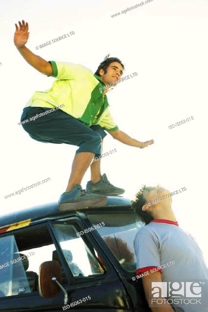 Stock Photo: Man standing on van.