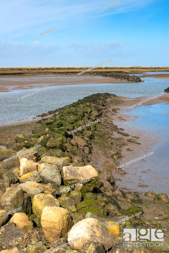 Stock Photo: Views of mudflat at low tide from Norfolk Coast path National Trail near Barnham Overy Staithe, East Anglia, England, UK.