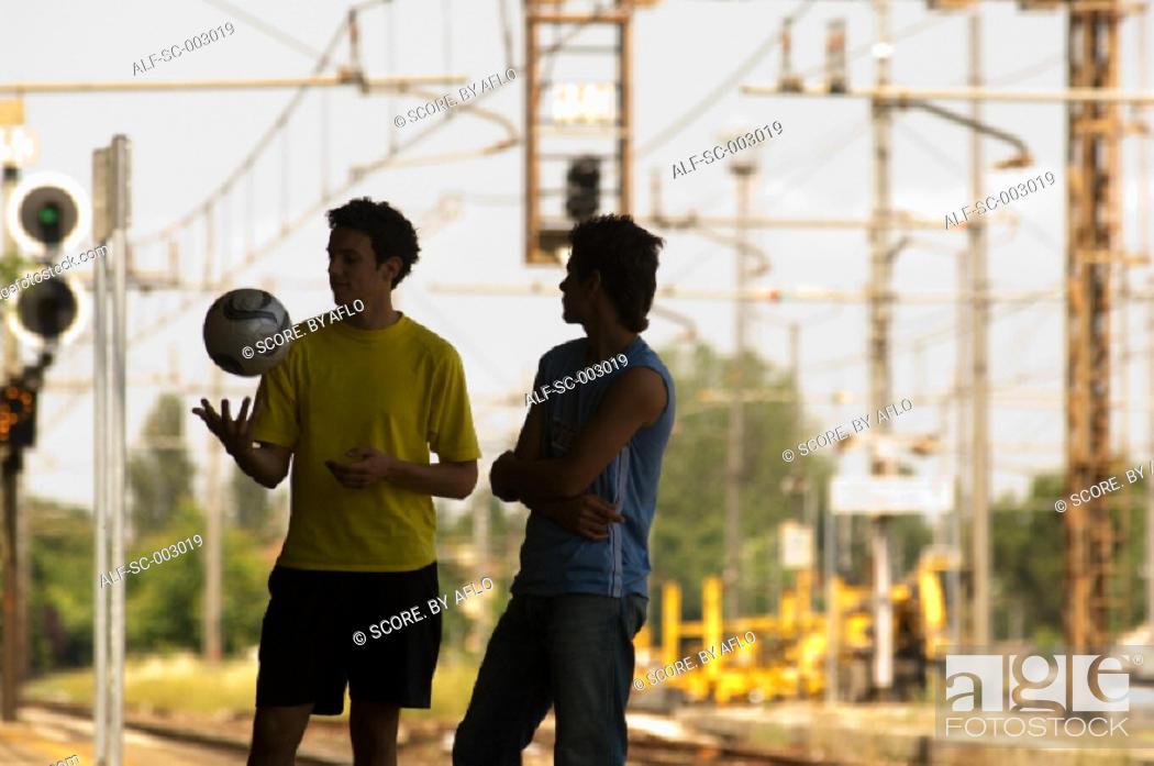 Stock Photo: Teenage boys on station platform.