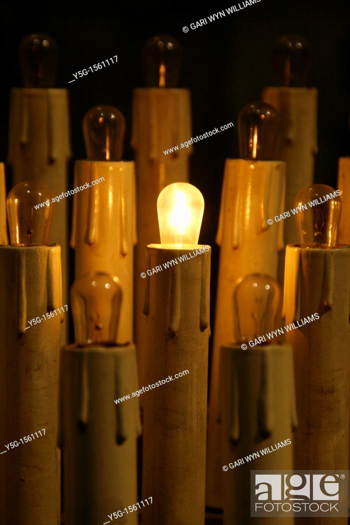 Stock Photo: plastic altar candles in church in rome.