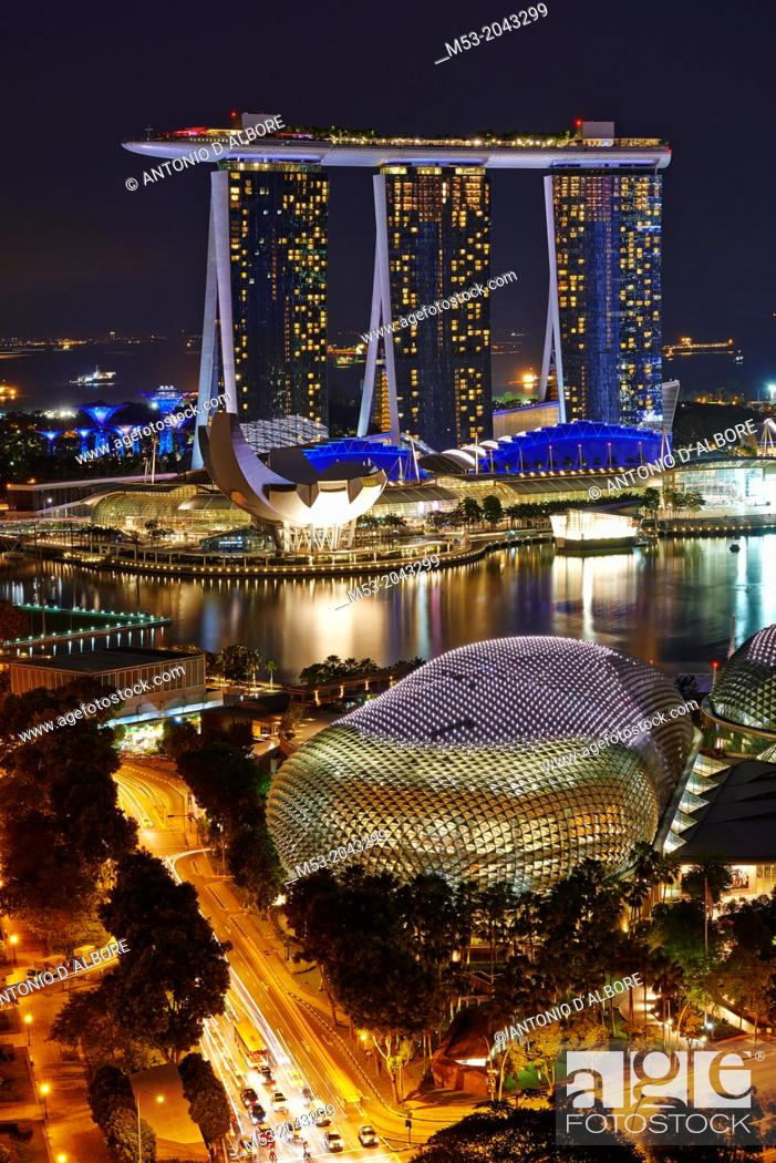 Stock Photo: Aerial view of Marina Bay at night. In foreground The Esplanade theatre while in the background the tall towers of Marina Bay Sands. Singapore.