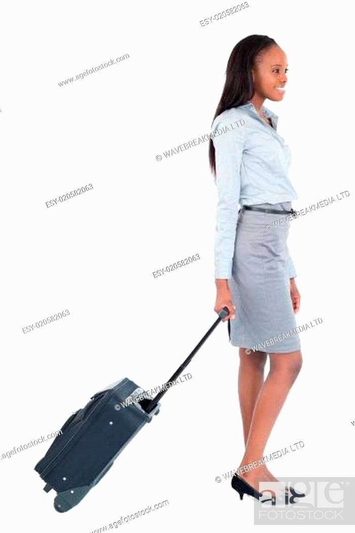 Imagen: Portrait of a businesswoman walking with a suitcase.