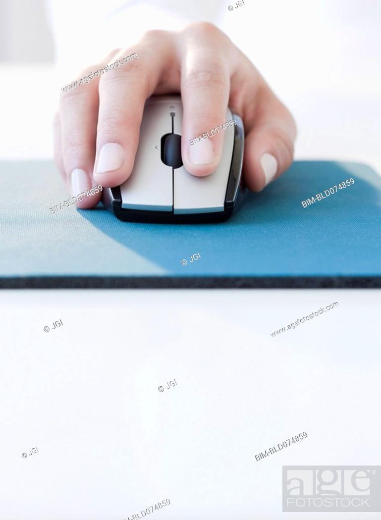 Stock Photo: Woman clicking on computer mouse.