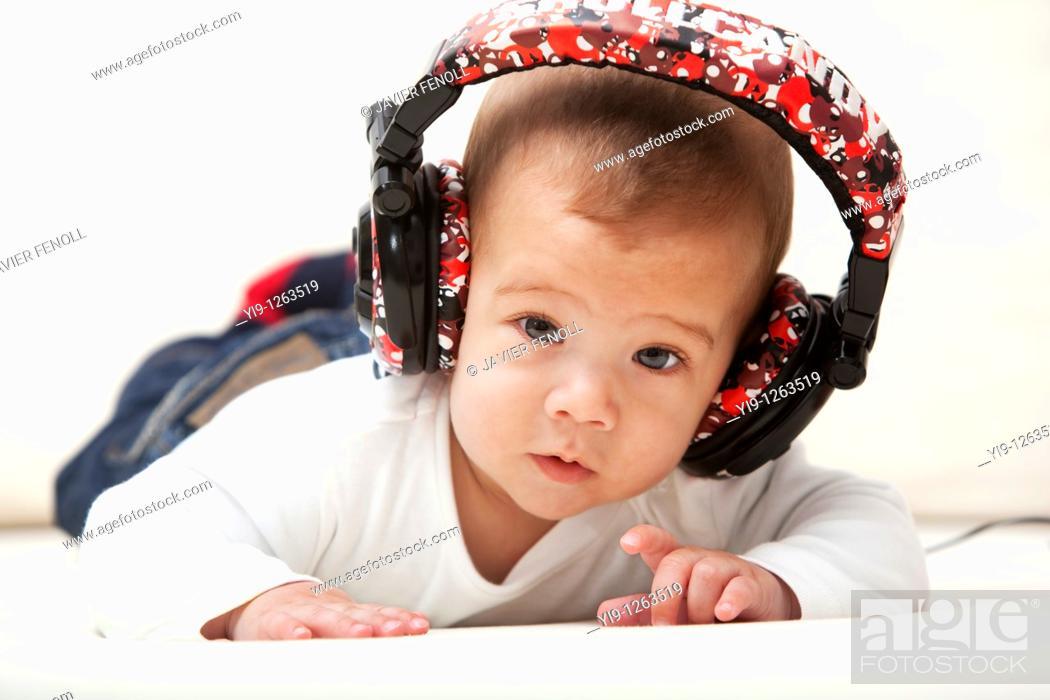 Stock Photo: Little child with headphones.