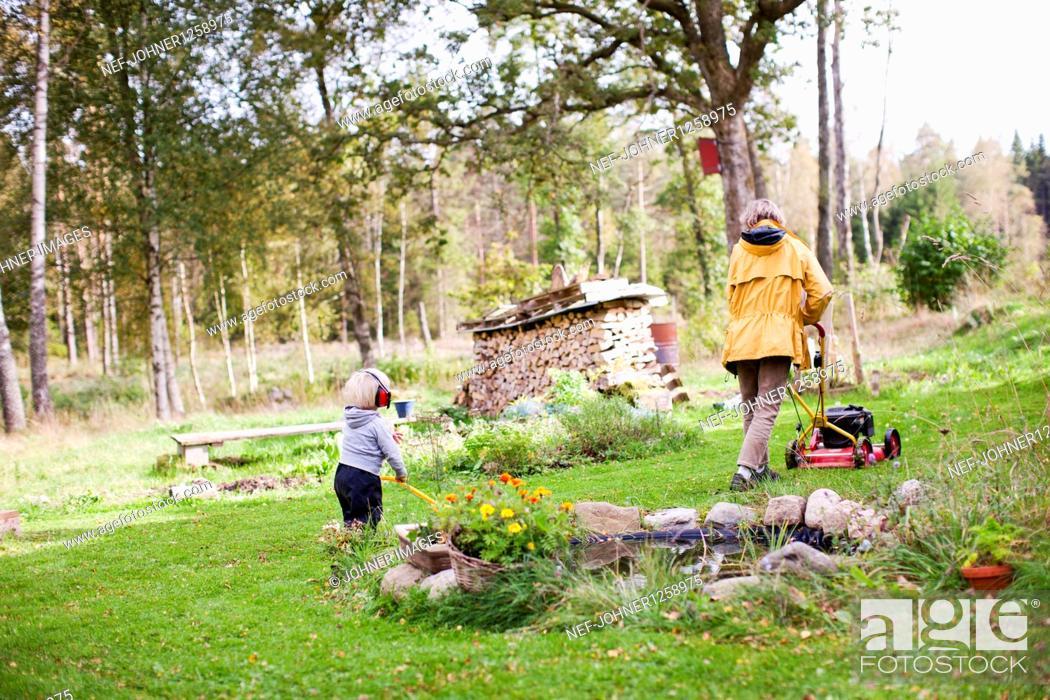 Stock Photo: Grandmother and granddaughter gardening.