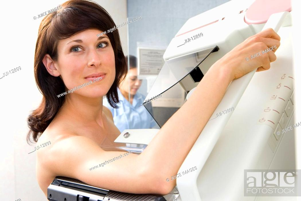 Stock Photo: Topless woman having mammogram, close-up.
