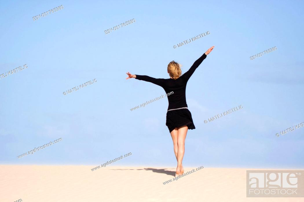 Stock Photo: Girl prtending to fly.