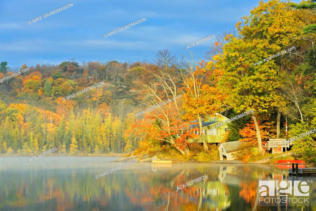Stock Photo: Cottage on Horseshoe Lake in morning fog Horseshoe Lake Ontario Canada.