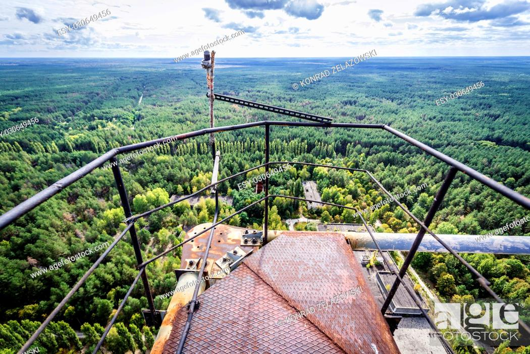 Stock Photo: On the top of old Soviet radar system called Duga near Cherobyl town in Chernobyl Nuclear Power Plant Zone of Alienation in Ukraine.