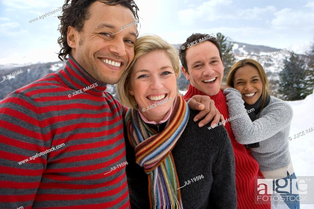 Stock Photo: Portrait of two couples in winter setting.
