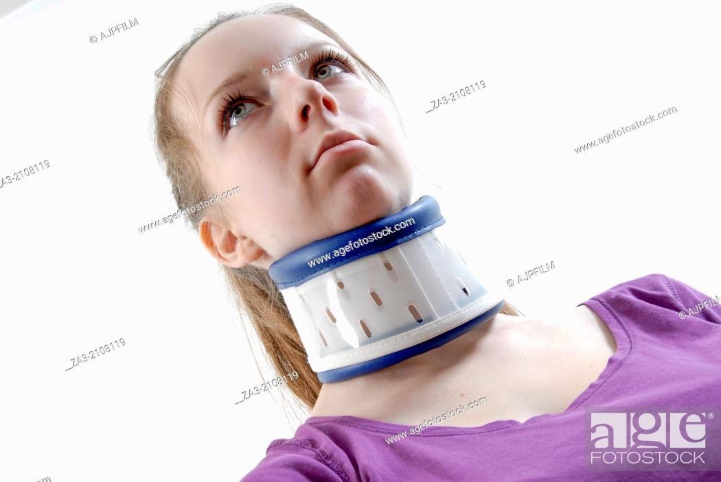 Stock Photo: Neck brace being worn by a young girl to provide support and pain relief from a neck injury.