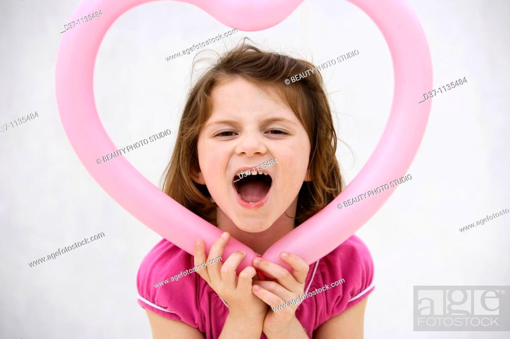 Stock Photo: Young girl holding heart.