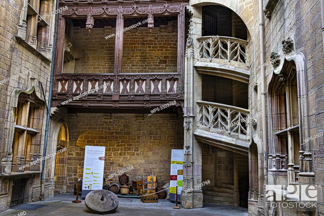 Stock Photo: Magnificent courtyard in a private mansion in Dijon, the Chambellan hotel, with his splendid staircase. Are exposed the necessary to make the famous Dijon.