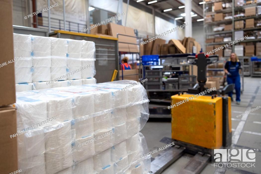 Stock Photo: 16 April 2020, Brandenburg, Großbeeren: Toilet paper is provided by the logistics service provider Rhenus Warehousing Solutions SE & Co.