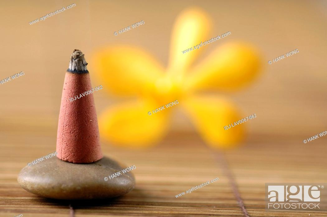 Stock Photo: Incense on a pebble.