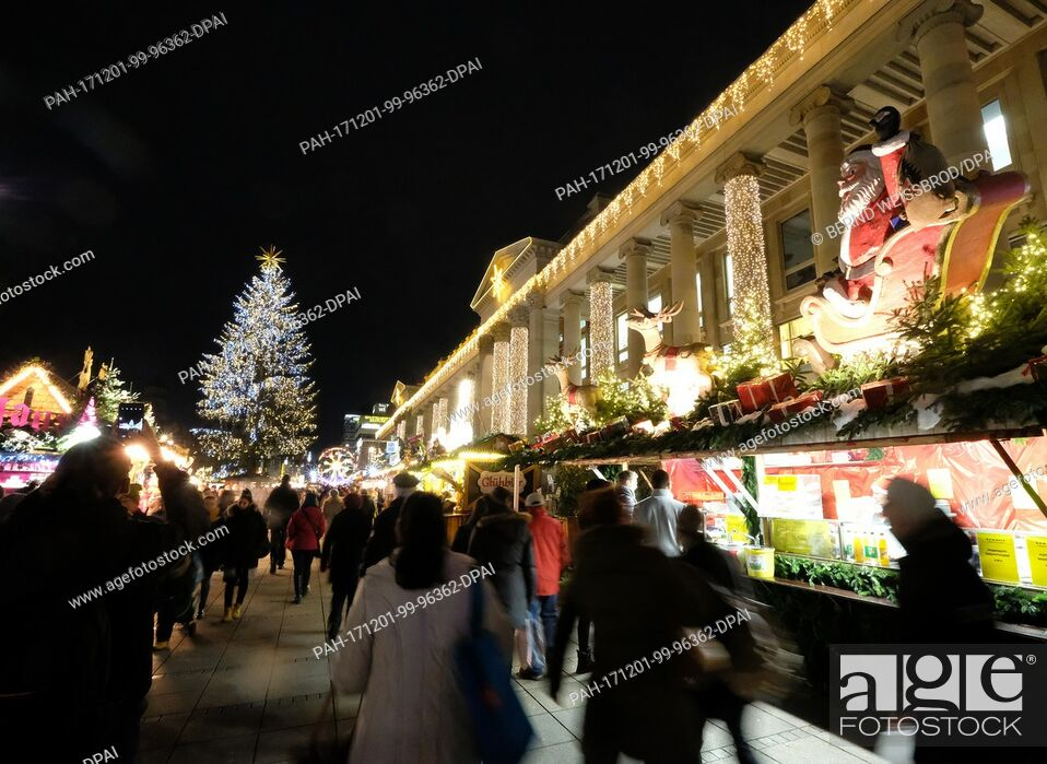 Stock Photo: An illuminated Christmas tree can be seen on the Christmas market on the castle square in Stuttgart, Germany, 30 November 2017.