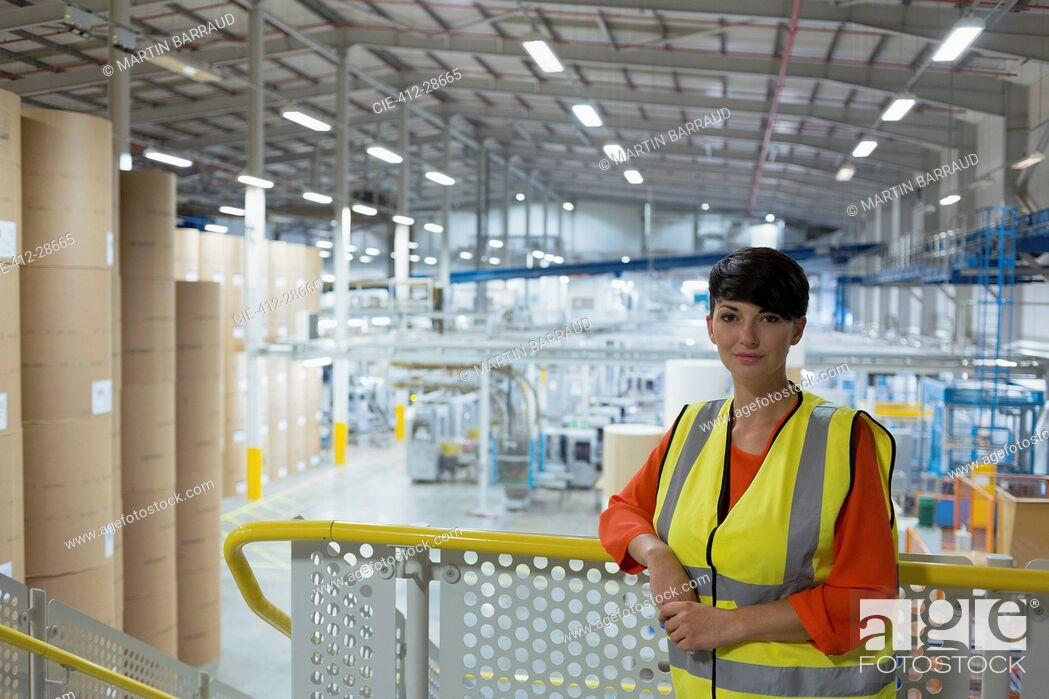 Stock Photo: Portrait confident worker on platform above factory.