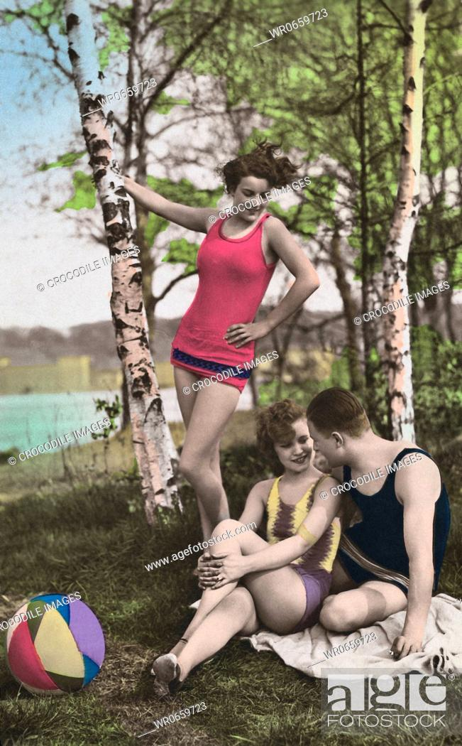 Stock Photo: Historical picture of man with two women by a lake.