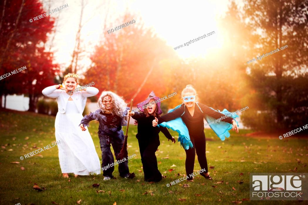 Stock Photo: Group of friends in Halloween costumes.