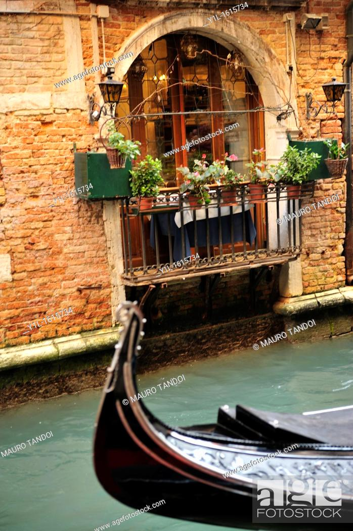 Stock Photo: Italy,Veneto,Venice,front of gondola passing.
