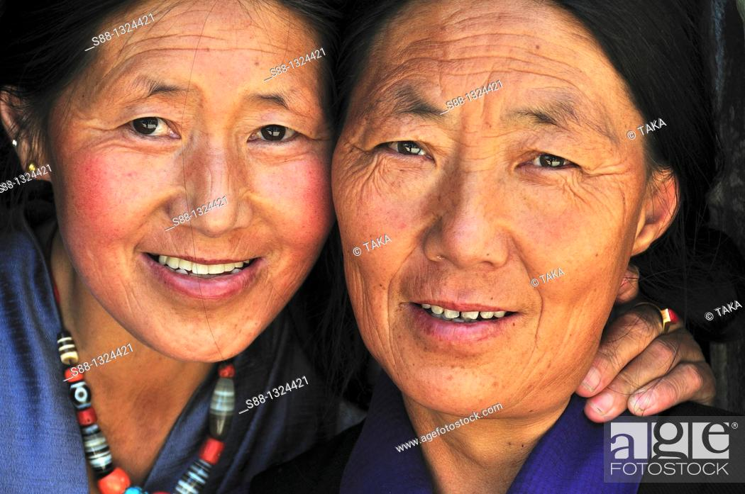 Stock Photo: Tibetan women at the shop on the main road.