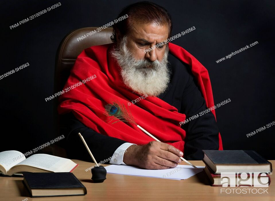 Stock Photo: Critic writing review on a book.