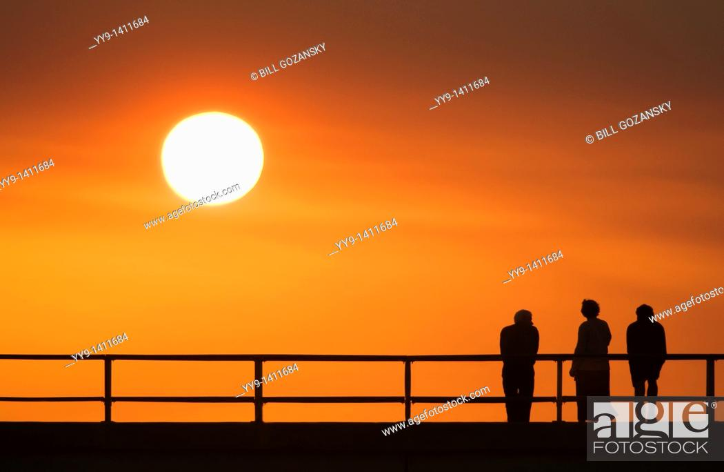 Stock Photo: People watching sunset on pier- Jekyll Island, Georgia.