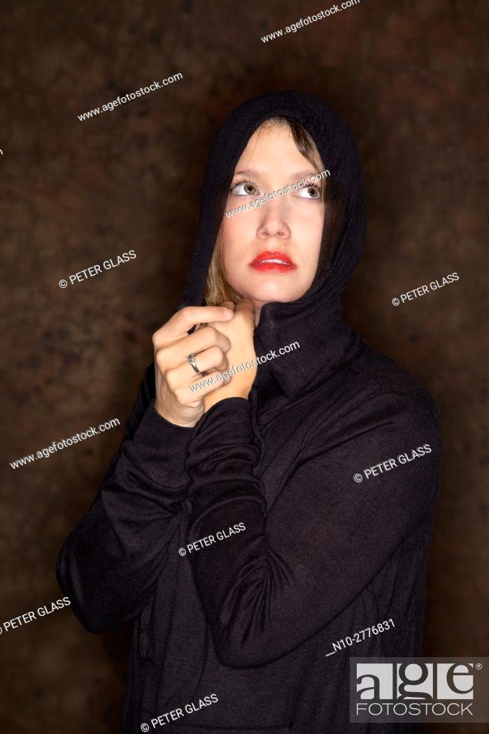 Stock Photo: Young woman wearing a hoodie.