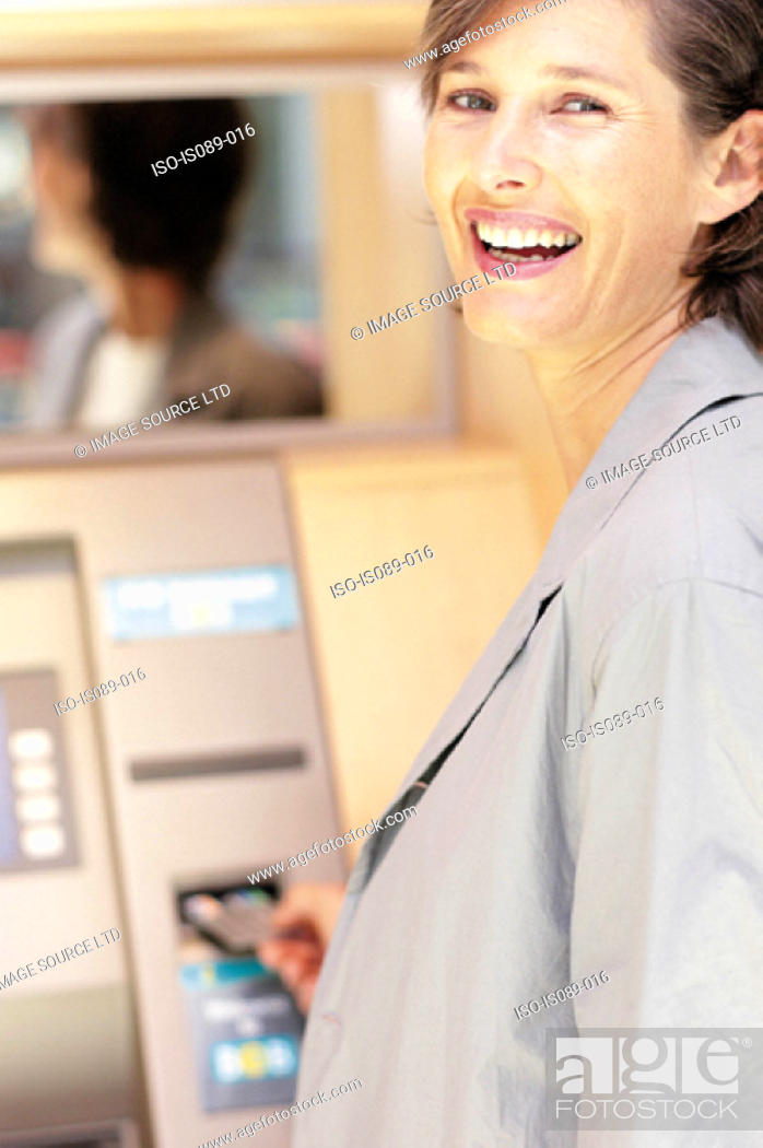 Stock Photo: Woman withdrawing cash.