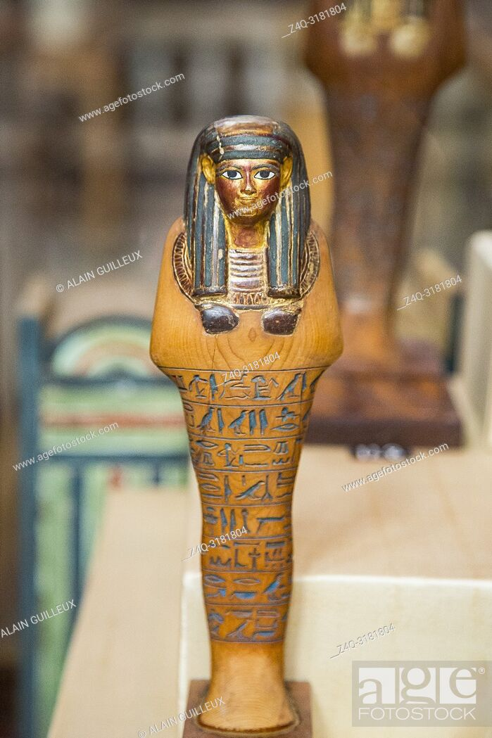 Stock Photo: Egypt, Cairo, Egyptian Museum, from the tomb of Yuya and Thuya in Luxor : Ushebti, in light coloured wood. The face, wig and necklace are gilded.