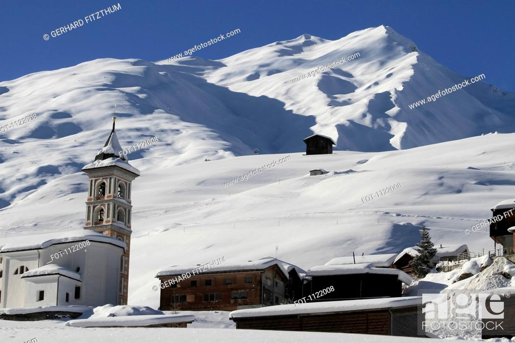 Stock Photo: Church and village in mountains.