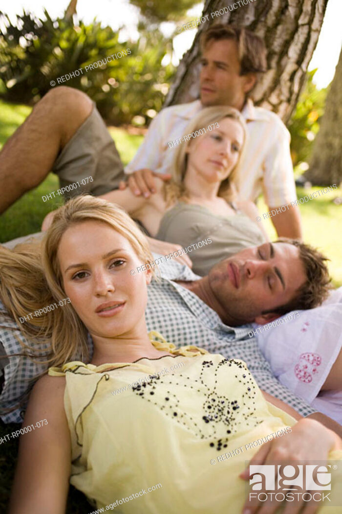 Stock Photo: Young couples in park.
