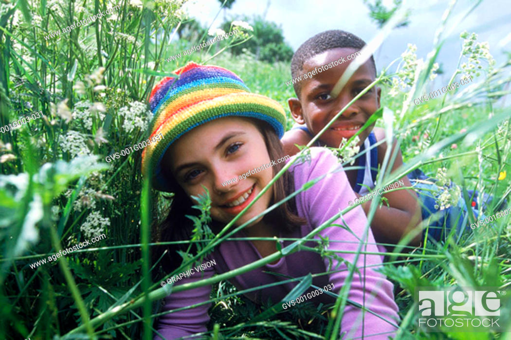 Stock Photo: Young children playing in the grass.