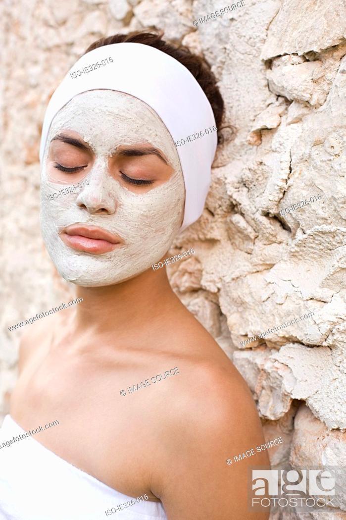 Stock Photo: Woman wearing face mask.