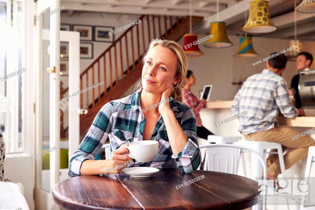 Stock Photo: Adult woman in a cafe.