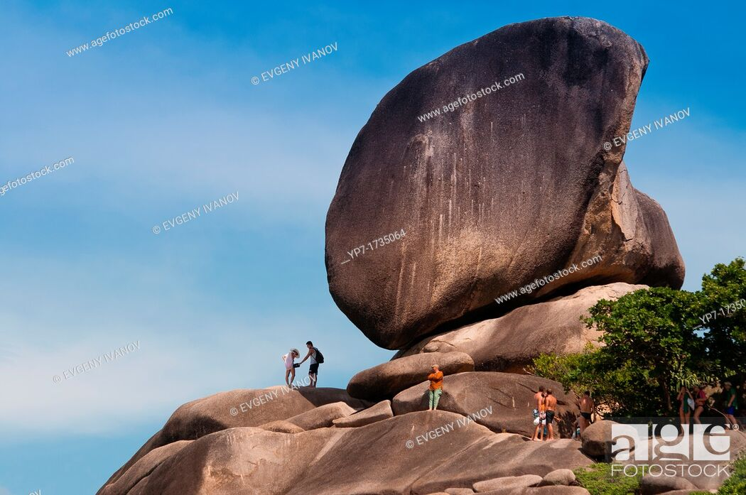 Stock Photo: People climbing to the Sail rock on Similan islands in Thailand.
