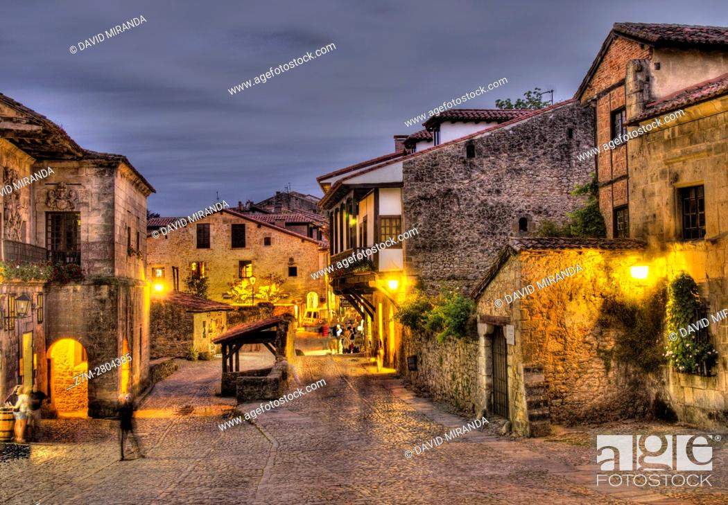 Stock Photo: Typical street at dusk, Santillana del Mar, Cantabria, Spain. Historical Heritage Site.