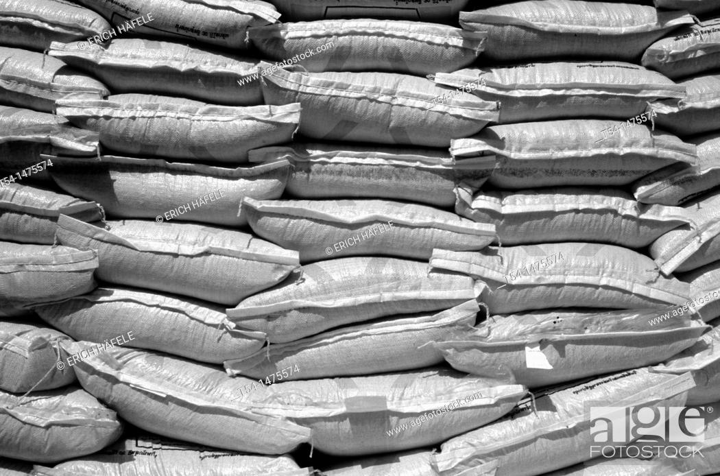 Stock Photo: Stacked bags of rice.