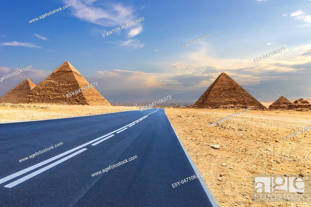 Stock Photo: Giza Pyramids and a road in the desert, Egypt, no people.