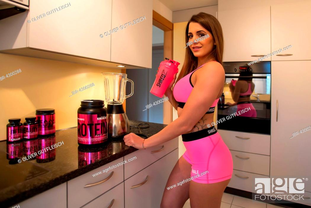 Stock Photo: Young woman with fitness drink.