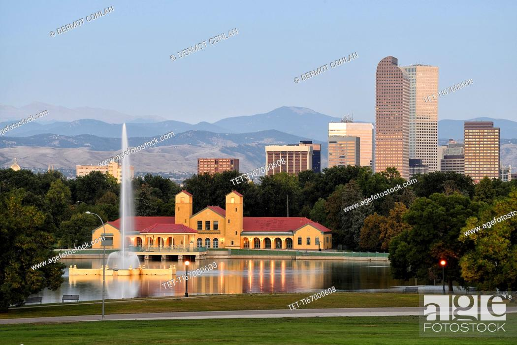 Stock Photo: USA, Colorado, Denver, City Park with buildings in background at sunrise.