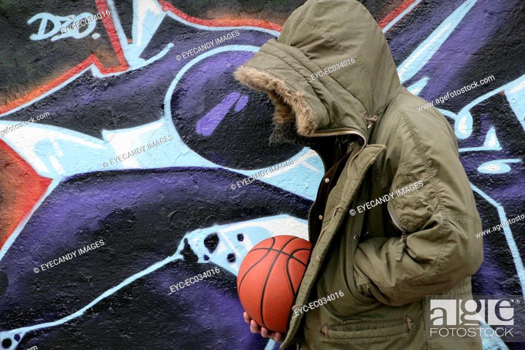 Stock Photo: View of a man near a graffiti.