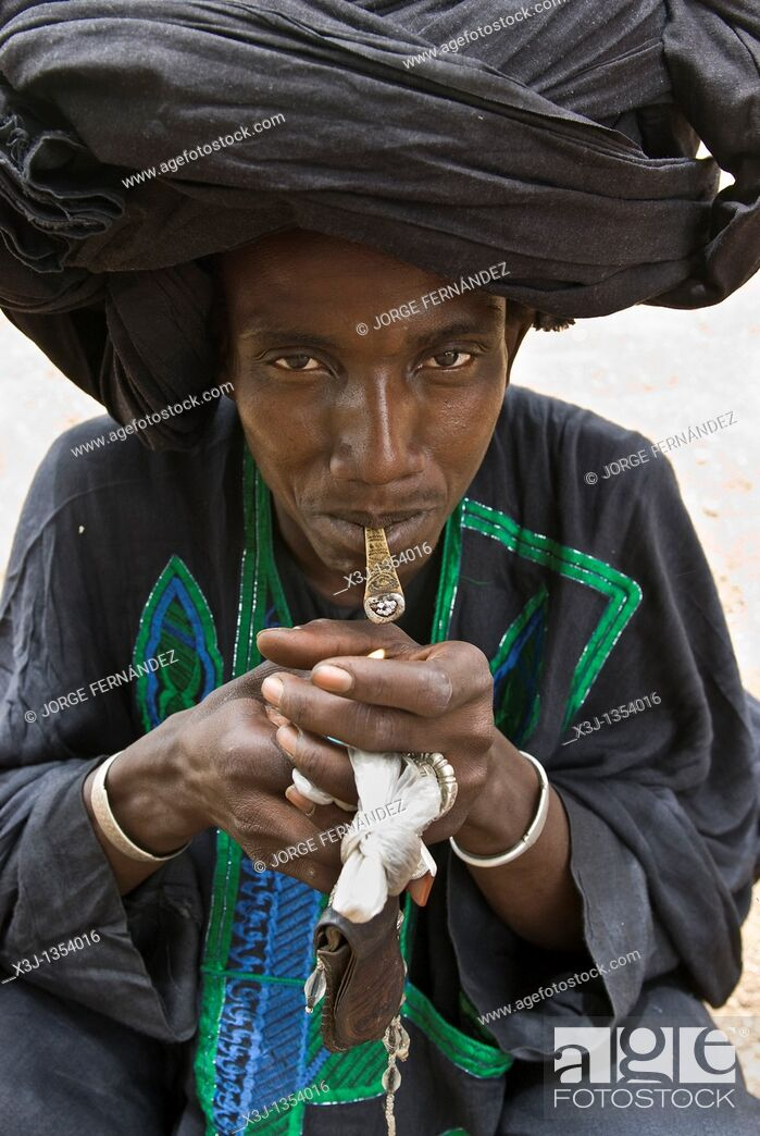 Stock Photo: Peul Shepherd, smoking  Ethiolo village, Bassari country, Senegal, Africa.