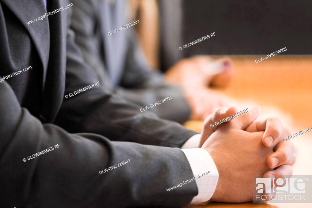 Stock Photo: Mid section view of two businessmen with their hands clasped.