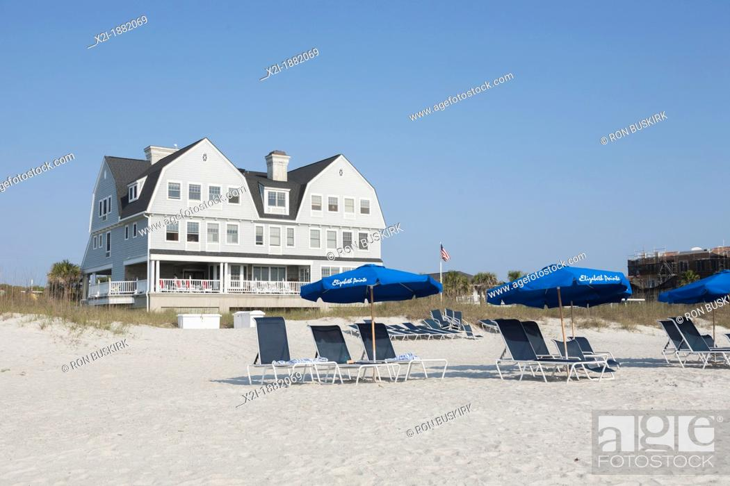 Stock Photo: Beach umbrellas line the waterfront at Elizabeth Pointe Lodge resort hotel at Amelia Island, Florida.